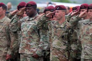 Sgt. 1st Class Clyde Tyner (right), a platoon sergeant with 5th Squadron, 73rd Cavalry Regiment, 3rd Brigade Combat Team, 82nd Airborne Division, salutes during a 74th D-Day commemoration ceremony June 6, 2018 at Utah Beach along the coast of France. Tyner along with more than 50 other paratroopers were selected to represent the 82nd Airborne Division during the events remembering the events of June 6, 1944 and throughout WWII.